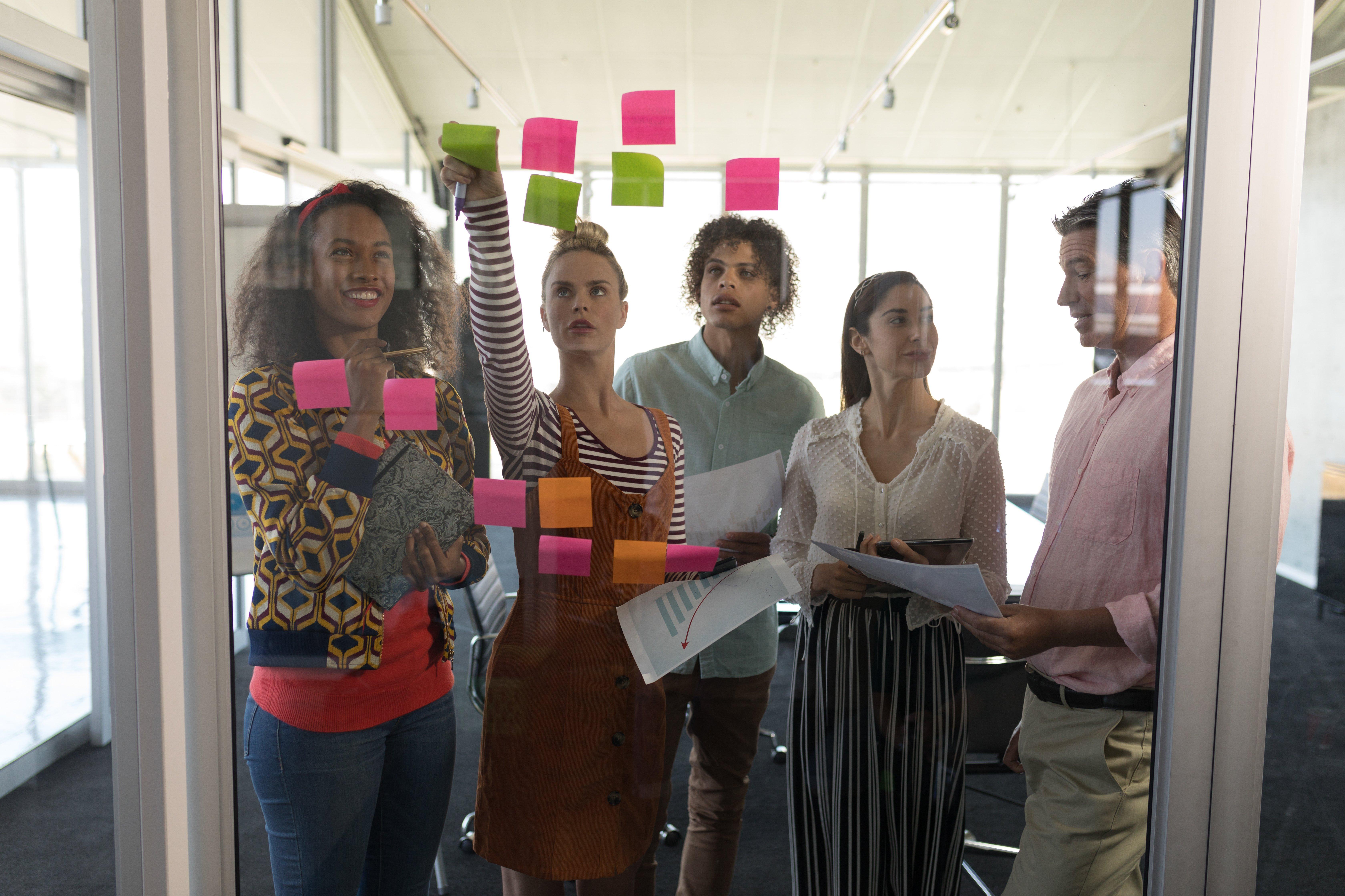 happy-creative-business-team-celebrating-success-A8Q38HY