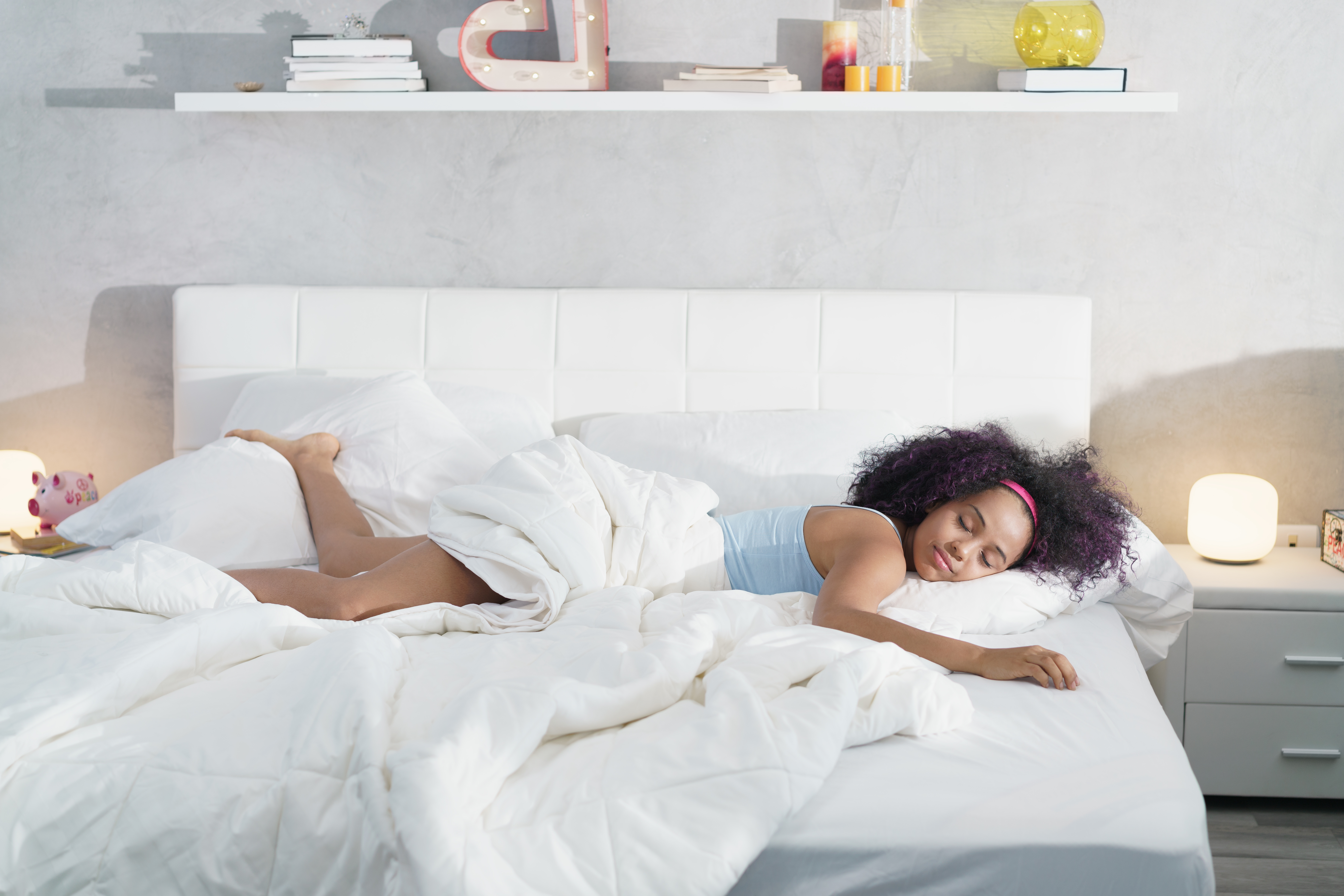 black-woman-sleeping-alone-in-large-bed-NF5HJ2E